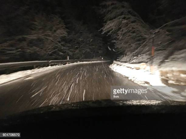 Driving a winter road at night during a blizzard (Upper Bavaria, Germany)