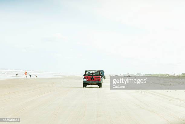 driving across carova beach in north carolina - jeep wrangler stock photos and pictures