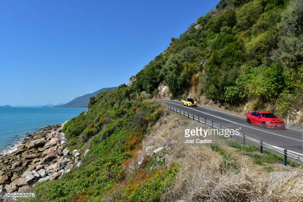 driving along coast between cairns and port douglas in queensland - cairns stock photos and pictures