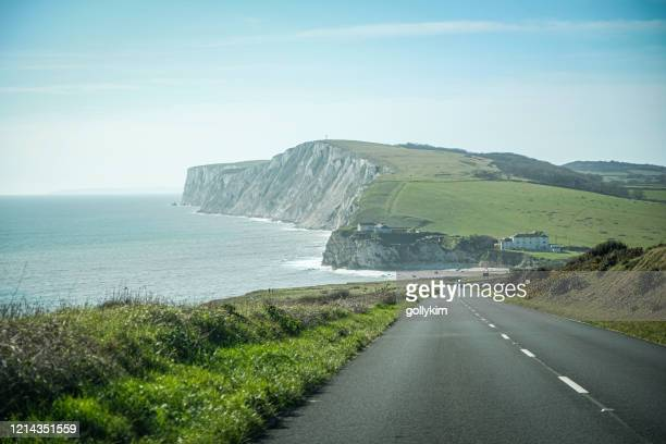 driving along freshwater bay, isle of wight, england - freshwater bay isle of wight stock pictures, royalty-free photos & images