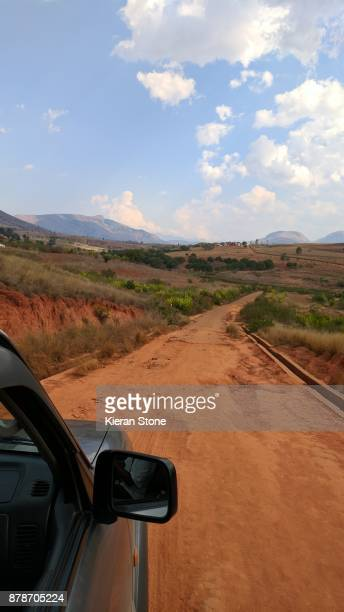 Driving Along Red Dirt Road