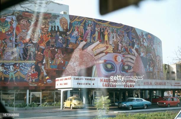 Driving along the Avenue de los Insurgentes with murals of Diego Rivera Mexico City Mexico December 1978