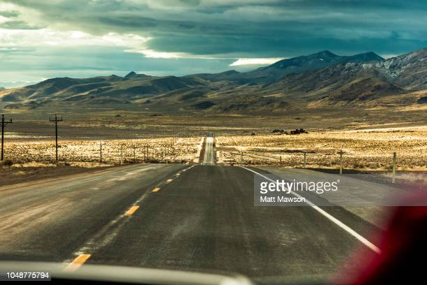 driving along the loneliest road in america the i50 in nevada state usa - nevada stock pictures, royalty-free photos & images