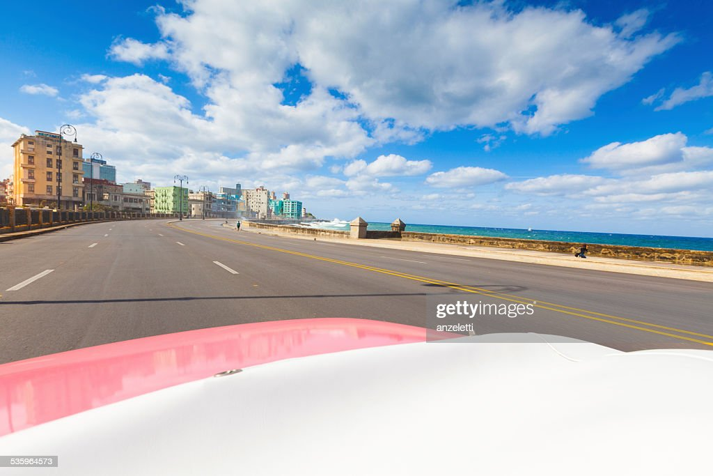 Driving along the Malecón in Havana : Stock Photo
