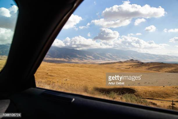 driving american car in a highway with the california landscape during road trip. - domestic car stock pictures, royalty-free photos & images