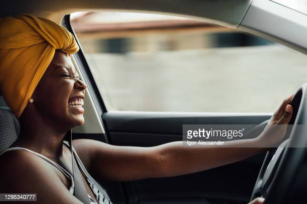 driving and smiling - car stock pictures, royalty-free photos & images