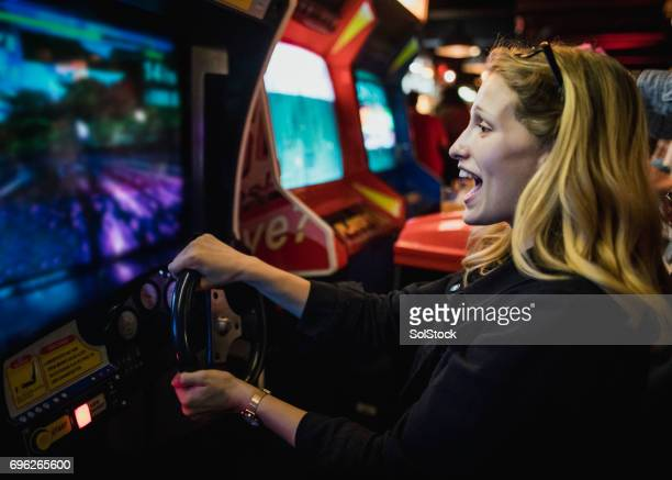 driving arcade - arcade stock photos and pictures