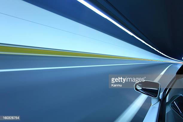driving at high speed in the tunnel - thruway stock pictures, royalty-free photos & images