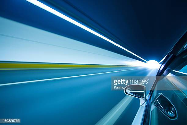 driving at high speed in tunnel - thruway stock pictures, royalty-free photos & images