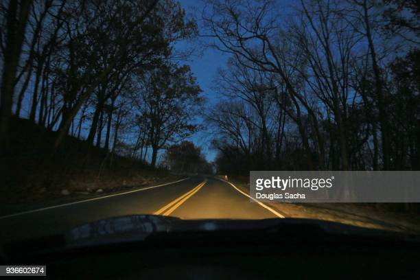 driving at night - dashboard camera point of view stock photos and pictures