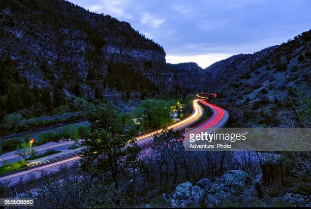 driving at night through glenwood canyon - interstate 70 stock photos and pictures