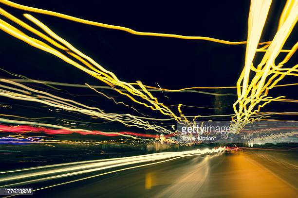 Driving at night with abstract city light trails, Amsterdam