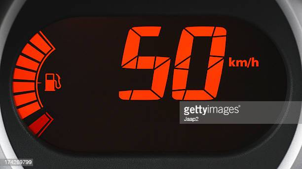 Driving at speed limit 50 km/h, close-up of digital dashboard