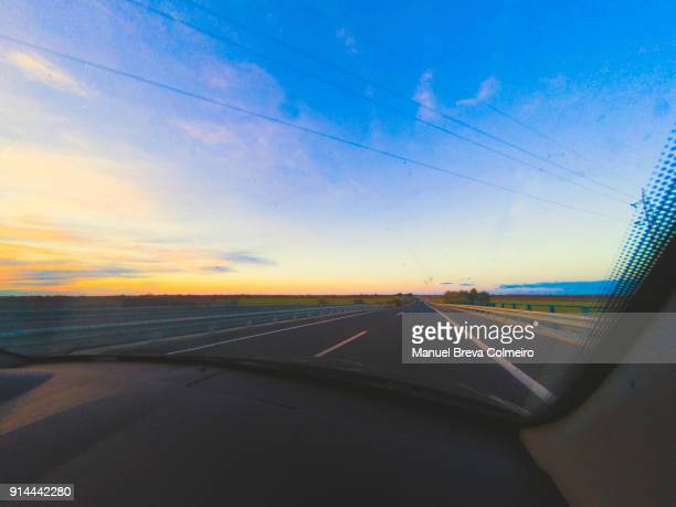 driving at sunset - green car crash stock pictures, royalty-free photos & images