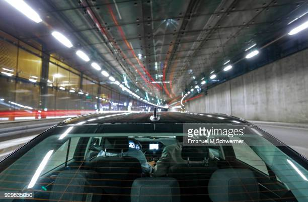 driving black German car with reflections and the rear window in foreground - mother of tunnel
