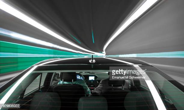 driving black German car with reflections and the rear window in foreground