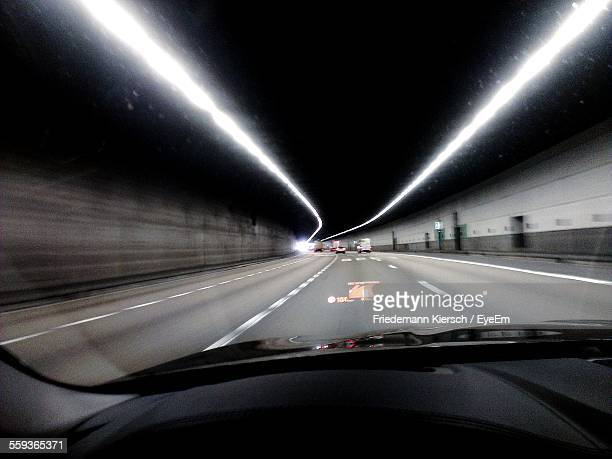 Driving Car In Illuminated Tunnel