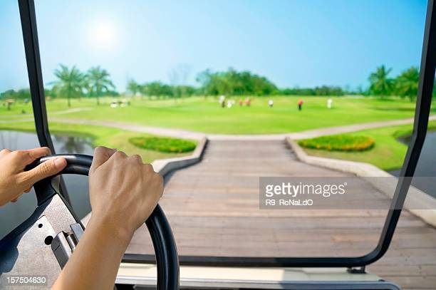 Driving cart at golf course in sunny day