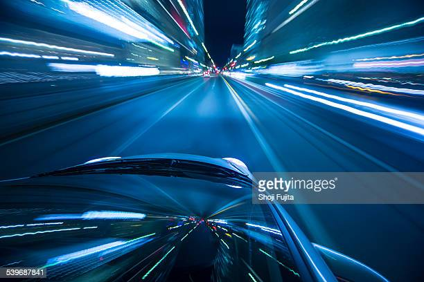 driving city at night. - land vehicle stock pictures, royalty-free photos & images