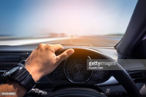 Driving concept Hand on steering wheel