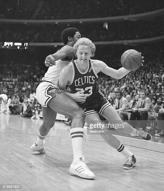 Driving for the basket Boston Celtics' Larry Bird puts a shoulder into Chicago Bulls David Greenwood in the first quarter action of the BullsCeltics...