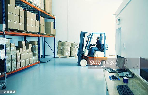 driving forklift at a small warehouse