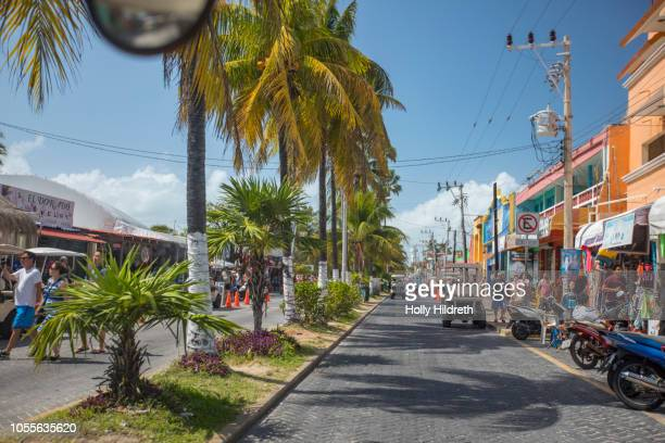 driving in golf cart on tropical island - isla mujeres stock photos and pictures