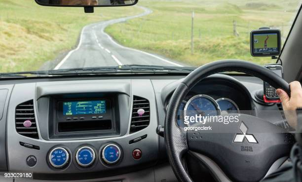 driving in scottish countryside - mitsubishi group stock pictures, royalty-free photos & images
