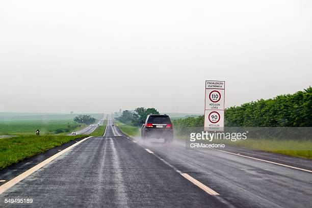 driving in the rain - crmacedonio stock photos and pictures