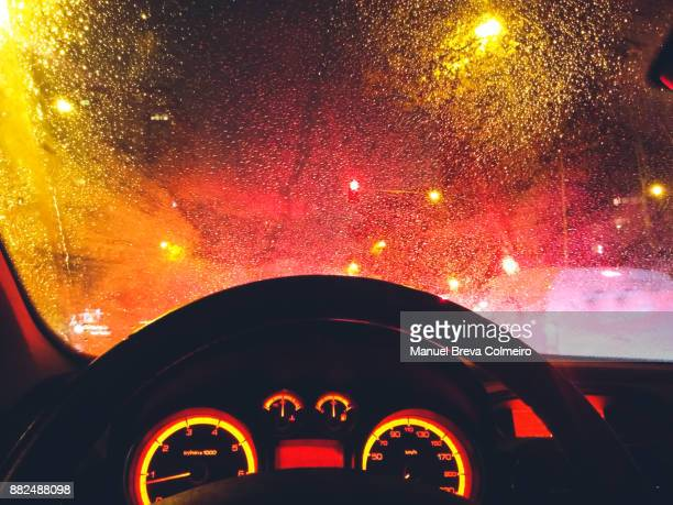 driving in the rain - green car crash stock pictures, royalty-free photos & images