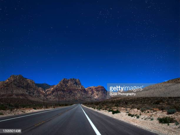 driving in the red rock canyon scenic loop drive, near las vegas, nevada. - american culture stock pictures, royalty-free photos & images