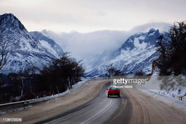driving in winter - argentina america del sud foto e immagini stock