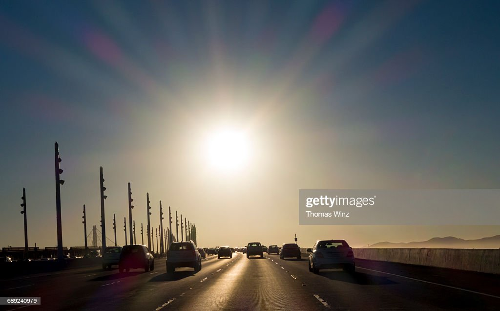 Driving into the sun : Stock Photo