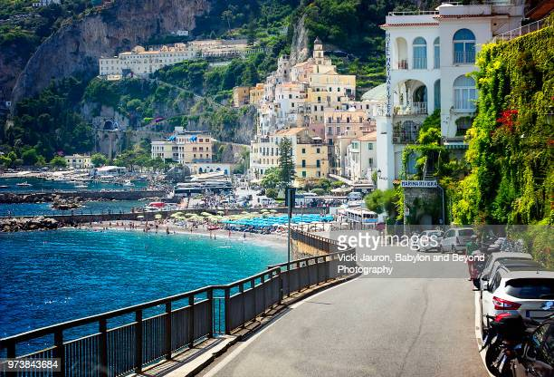 driving into the village of amalfi on the amalfi coast of italy - amalfi coast stock photos and pictures