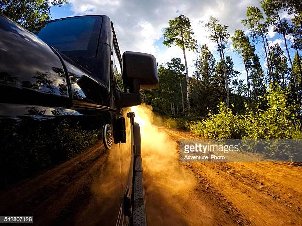 Driving Jeep Up Dirt Road Dust Trail