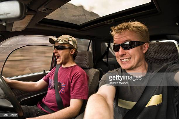 Driving man and friend