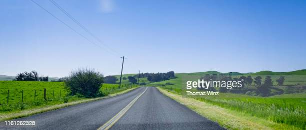 driving on a country road - country road stock pictures, royalty-free photos & images