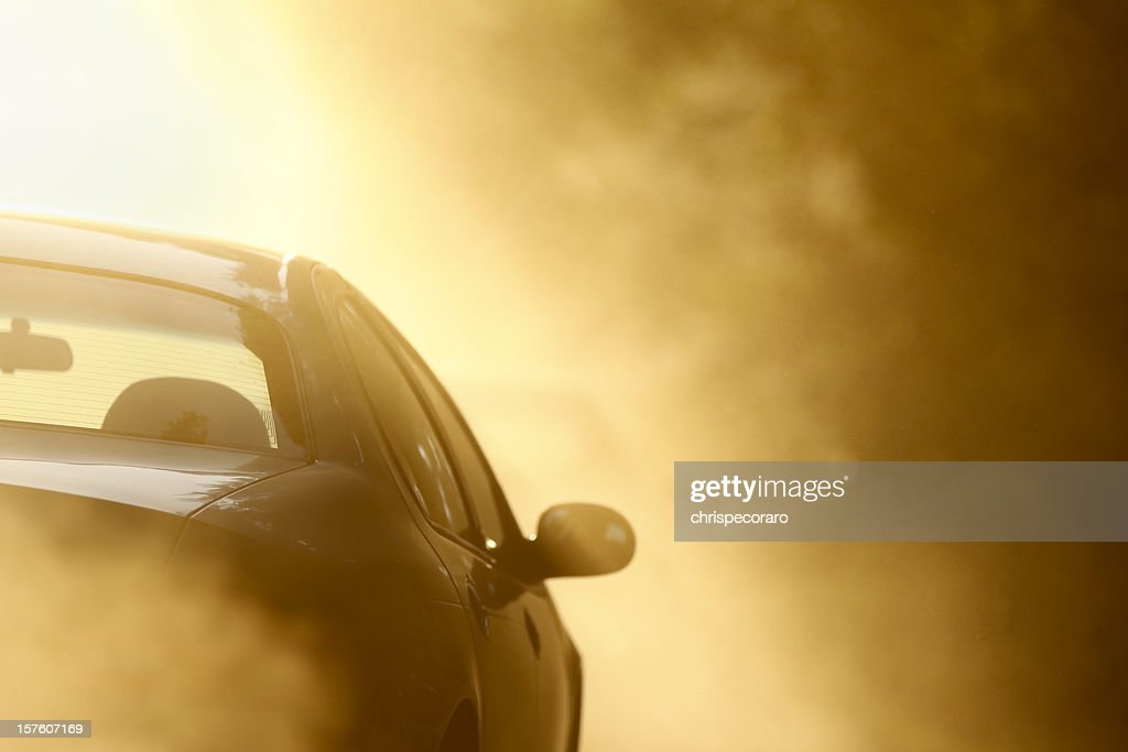 Driving on a Dusty Dirt Road : Stock Photo