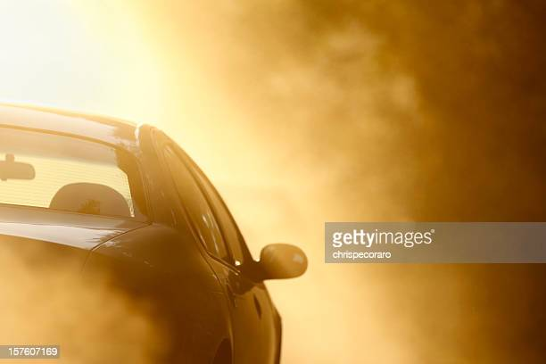 driving on a dusty dirt road - heat stock pictures, royalty-free photos & images