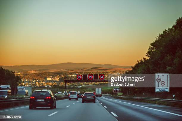 "Driving on a freeway / motorway / ""Autobahn"" at sunset"
