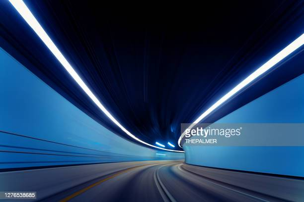 driving on empty traffic tunnel during pandemic 2020 - micro organism stock pictures, royalty-free photos & images