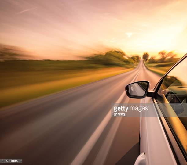 driving on the road - land vehicle stock pictures, royalty-free photos & images