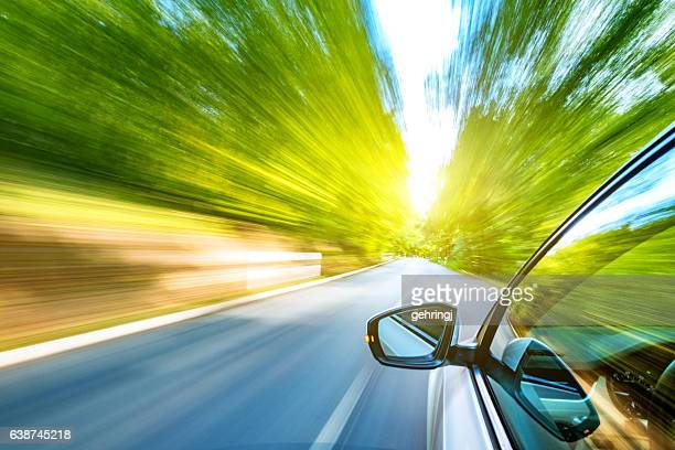 driving on the road - motion blur stock photos and pictures
