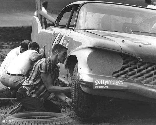 Driving one of the Petty Engineering '60 Plymouths Jim Paschal makes a pit stop at AshevilleWeaverville Speedway during the Western North Carolina...