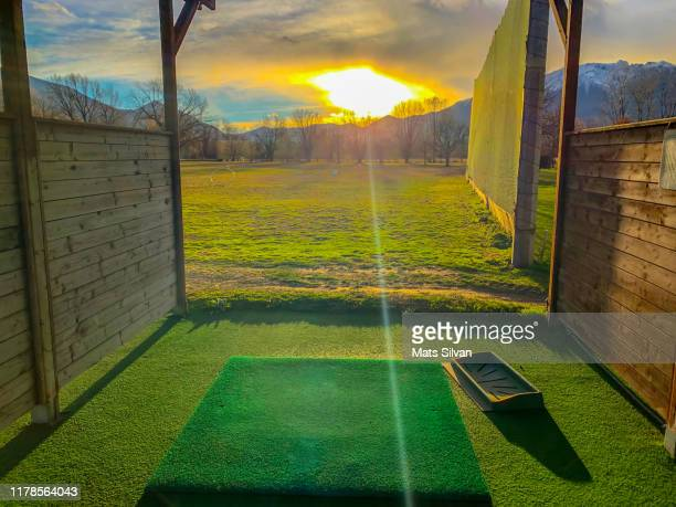driving range with sunlight and mountain - driving range stock pictures, royalty-free photos & images