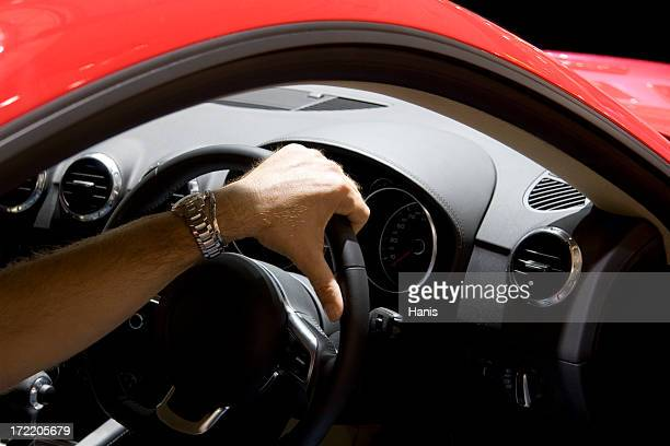 Driving red sports car