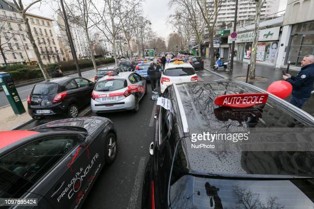Driving school vehicles are parked Place d'Italie in Paris on February 11 as driving schools managers protest against a parliamentary report which...