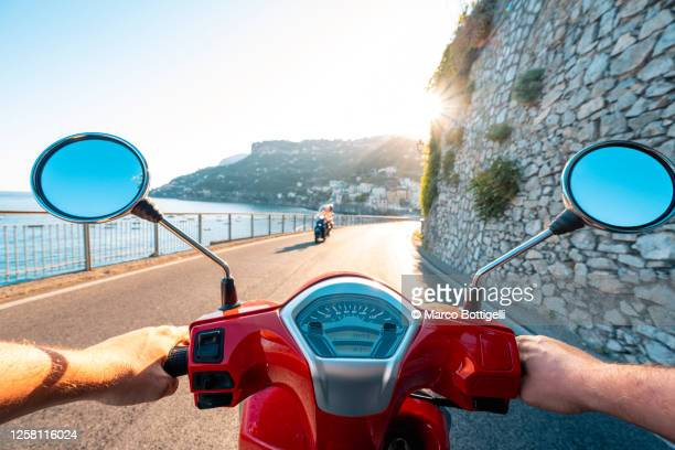 driving scooter along the amalfi coast, italy. personal perspective. - mediterranean culture stock pictures, royalty-free photos & images