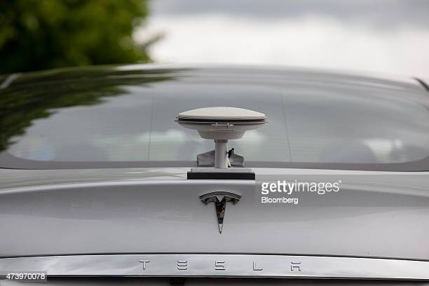 A GPS driving sensor antennae sits on the back of a Tesla Motors Inc Model S electric automobile at the Robert Bosch GmbH driverless technology press...