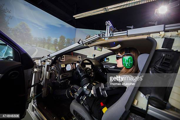 Driving simulator chair Ergonomics and Innovation Management at the TU Chemnitz Investigation of driving assistance systems A woman wearing a suit...